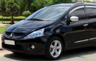 Bán Mitsubishi Grandis 2.4Mivec đời 2009, màu đen chính chủ, giá tốt giá 560 triệu tại Tp.HCM