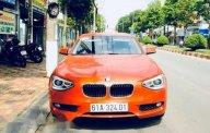 Chính chủ bán BMW 1 Series 116i đời 2014, màu cam giá 799 triệu tại Bình Dương