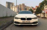Bán xe BMW 3 Series 320i năm 2015, màu trắng  giá 1 tỷ 150 tr tại Hà Nội