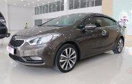 Bán xe Kia K3 1.6 AT đời 2014, màu nâu, xe tư nhân, sang tên nhanh chóng giá 515 triệu tại Tp.HCM