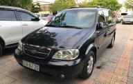 Bán Kia Carnival GS 2.5 AT sản xuất 2009, màu đen giá 300 triệu tại Tp.HCM