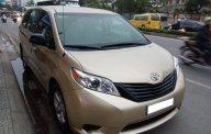 Cần bán xe Toyota Sienna 2.7 LE 2010 màu vàng cát nhập Mỹ giá 1 tỷ 360 tr tại Tp.HCM