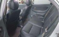 Bán xe Kia Spectra sản xuất 2004, màu đen, 100tr giá 100 triệu tại Bình Dương