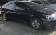 Chính chủ cần bán Toyota Corolla altis 1.8 AT, màn hình hiển thị kỹ thuật số, sản xuất năm 2016, màu đen giá 730 triệu tại Hà Nội
