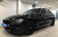 Cần bán lại xe BMW 3 Series 320i năm sản xuất 2013, màu đen, nhập khẩu nguyên chiếc, giá chỉ 865 triệu giá 865 triệu tại Tp.HCM