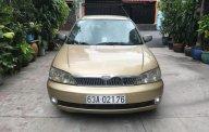 Bán xe Ford Laser sản xuất 2002, màu vàng, 200tr giá 200 triệu tại Tp.HCM