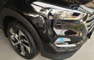 Bán xe Hyundai Tucson 1.6 AT Turbo đời 2018, màu đen, 900 triệu giá 900 triệu tại Tp.HCM
