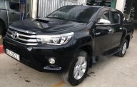Cần bán lại xe Toyota Hilux đời 2015, màu đen, giá tốt giá 708 triệu tại Tp.HCM