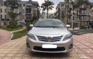 Bán Toyota Corolla altis 1.8 đời 2013, màu bạc chính chủ giá 590 triệu tại Hà Nội