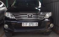Cần bán lại xe Toyota Fortuner năm 2012 màu đen, 720 triệu giá 720 triệu tại Tp.HCM