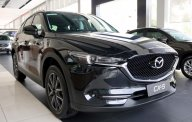 Cần bán Mazda CX 5 2.0 AT năm 2018, màu đen, giá cạnh tranh. giá 899 triệu tại Tp.HCM