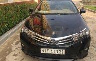 Bán xe Toyota Corolla altis đời 2016, màu đen giá 698 triệu tại Tp.HCM