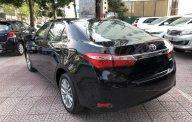 Cần bán xe Toyota Corolla Altis 1.8G MT sản xuất năm 2014, màu đen giá cạnh tranh giá 595 triệu tại Hà Nội