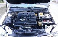Bán ô tô Daewoo Lacetti EX 1.6 MT đời 2004, màu trắng giá 126 triệu tại Bình Định