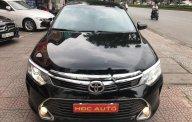 Bán ô tô Toyota Camry 2.0E 2015, màu đen giá 875 triệu tại Hà Nội