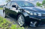 Cần bán lại xe Toyota Corolla altis 1.8G đời 2015, màu đen chính chủ giá cạnh tranh giá 659 triệu tại Hà Nội