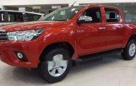 Bán ô tô Toyota Hilux 2.4E đời 2018, màu cam giá 631 triệu tại Hà Nội
