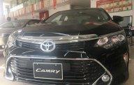 Cần bán gấp Toyota Camry đời 2018, màu đen, giá tốt giá 1 tỷ 302 tr tại Tp.HCM