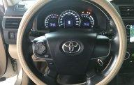 Bán Toyota Camry 2.0E màu vàng cát số tự động sản xuất T12/2014 biển Bình Dương lăn bánh đúng 39000km giá 788 triệu tại Tp.HCM