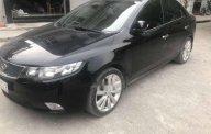 Bán ô tô Kia Forte năm 2010, màu đen, giá tốt giá 385 triệu tại Tp.HCM