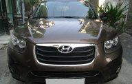 Cần bán Hyundai Santafe 2012 tự động, máy dầu, nâu vàng cực đẹp giá 698 triệu tại Tp.HCM