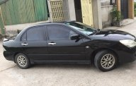 Bán xe Mitsubishi Lacer 1.8 AT 2003 màu đen giá 235 triệu tại Tp.HCM