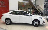 Bán ô tô Toyota Corolla Altis 1.8E CVT sản xuất 2018, màu trắng, giá 707tr giá 707 triệu tại Tp.HCM