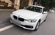 Cần bán gấp BMW 320i năm 2016, màu trắng giá 1 tỷ 210 tr tại Hà Nội