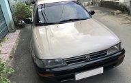 Bán xe Toyota Corolla 1.6MT sản xuất 1994, đăng kí 1996 màu đồng giá 165 triệu tại Tp.HCM