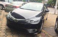 Cần bán xe Toyota Corolla altis 1.8E CVT đời 2018, màu đen giá 707 triệu tại Hà Nội