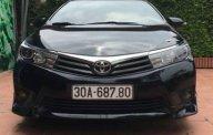 Chính chủ bán Toyota Corolla altis 2.0V đời 2015, màu đen giá 740 triệu tại Hà Nội