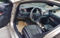 Bán Toyota Camry năm sản xuất 2014, màu vàng như mới giá 910 triệu tại Tp.HCM