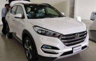 Cần bán xe Hyundai Tucson năm 2018, màu trắng giá 882 triệu tại Tp.HCM