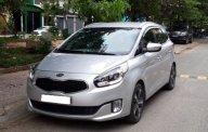 Nhà mình cần bán chiếc ô tô Kia Rondo đời 2015, số tự động máy dầu, màu xám bạc giá 615 triệu tại Tp.HCM