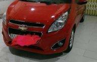 Bán Chevrolet Spark AT sản xuất năm 2014, màu đỏ, giá 265tr giá 265 triệu tại Tp.HCM