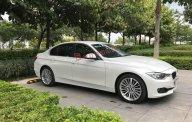 Bán ô tô BMW 3 Series 320i đời 2014, màu trắng, nhập khẩu giá 980 triệu tại Tp.HCM