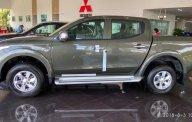 Bán xe bán tải Mitsubishi 1 cầu tự động, màu xanh rêu ở Quảng Bình. LH: 0911821513 giá 555 triệu tại Quảng Bình