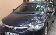 Bán xe Honda Civic 1.8 MT năm 2010, màu đen còn mới giá 390 triệu tại Tp.HCM