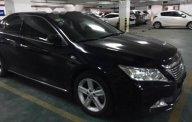Bán Toyota Camry năm sản xuất 2014, màu đen chính chủ giá 870 triệu tại Tp.HCM