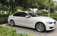 Bán BMW 3 Series AT đời 2014, màu trắng như mới, giá 980tr giá 980 triệu tại Tp.HCM
