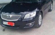 Cần bán xe Toyota Camry 2.4G đời 2007, màu đen chính chủ, giá tốt giá 225 triệu tại Tp.HCM