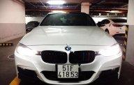 Cần bán gấp BMW 3 Series 320i sản xuất 2012, màu trắng  giá 820 triệu tại Tp.HCM