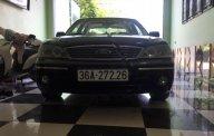 Cần bán gấp Ford Laser 1.8 AT sản xuất 2005, màu đen giá 245 triệu tại Yên Bái