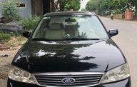 Bán Ford Laser AT năm 2005, màu đen như mới  giá 235 triệu tại Hà Nội