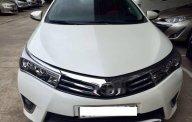 Bán xe Toyota Corolla altis 1.8AT sản xuất 2015, màu trắng  giá 680 triệu tại Tp.HCM