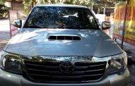 Cần bán Toyota Hilux 3.0 sản xuất 2014, màu bạc giá 595 triệu tại Nghệ An