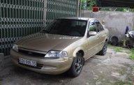 Cần bán Ford Laser năm sản xuất 2001, màu vàng giá 170 triệu tại Tiền Giang