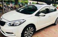 Gia đình bán Kia K3 1.6 MT đời 2015, màu trắng  giá 475 triệu tại Quảng Nam