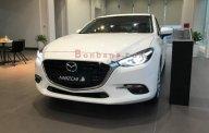Bán xe Mazda 3 1.5 AT sản xuất 2018, màu trắng giá cạnh tranh giá 659 triệu tại Hà Nội