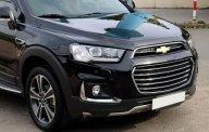 Bán Chevrolet Captiva LTZ Revv sản xuất năm 2016, màu đen, đúng 28.000 km giá 735 triệu tại Tp.HCM